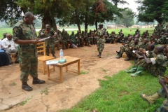 col g kibirango chief of cmrc joins members in singing during sensitization exercise 2013